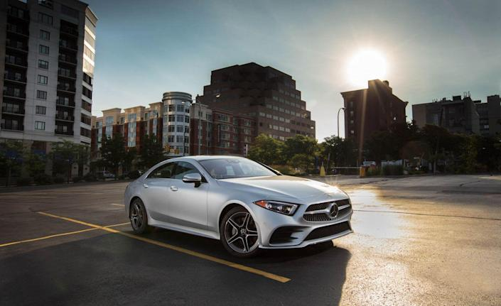 """<p>Calling <a href=""""https://www.caranddriver.com/mercedes-benz/cls-class"""" rel=""""nofollow noopener"""" target=""""_blank"""" data-ylk=""""slk:the 2019 Mercedes-Benz CLS450"""" class=""""link rapid-noclick-resp"""">the 2019 Mercedes-Benz CLS450</a> a hybrid is being a bit generous—<a href=""""https://www.caranddriver.com/reviews/a22794077/2019-mercedes-benz-cls-new-engine/"""" rel=""""nofollow noopener"""" target=""""_blank"""" data-ylk=""""slk:its EQ Boost system"""" class=""""link rapid-noclick-resp"""">its EQ Boost system</a> qualifies as a simpler mild-hybrid setup. It consists mainly of an electric motor sandwiched between the engine and transmission that is employed to restart the engine after the computers shut it down while the vehicle is stopped at a red light or in traffic. The motor also is capable of providing a small boost of power at low speeds, while acting as a generator when the vehicle is slowing to a stop to recover energy for the 48-volt battery pack that powers it.<br></p>"""