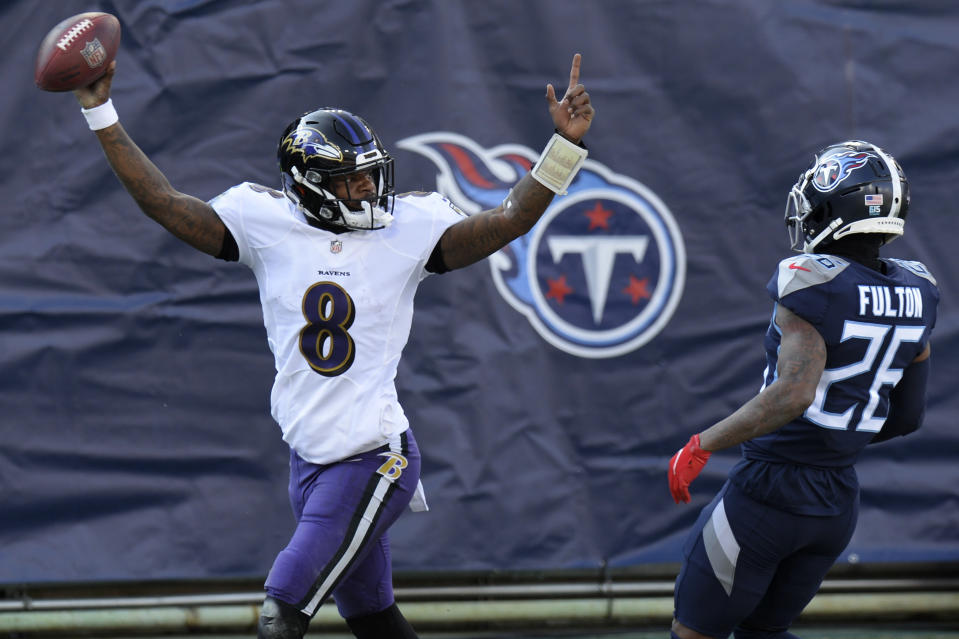 Baltimore Ravens quarterback Lamar Jackson (8) celebrates after scoring a touchdown on a 48-yard run against the Tennessee Titans. (AP Photo/Mark Zaleski)