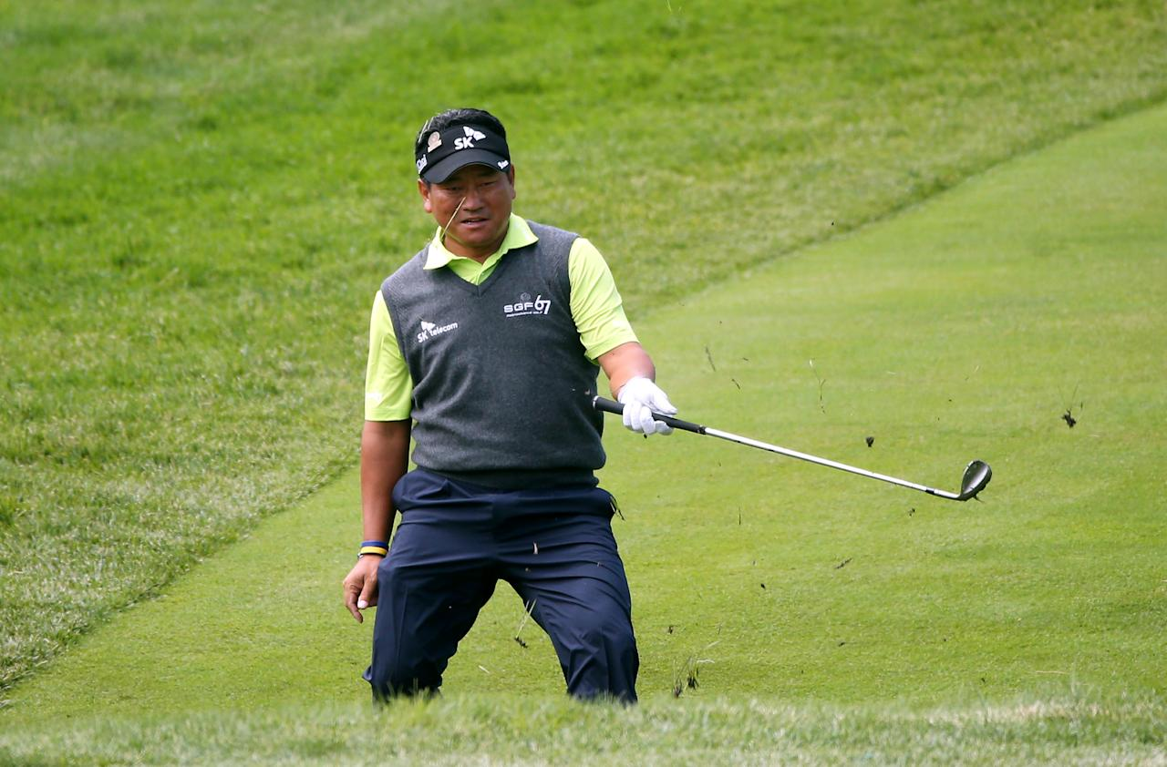 ARDMORE, PA - JUNE 14:  K.J. Choi of Korea hits an approach shot on the fourth hole during Round Two of the 113th U.S. Open at Merion Golf Club on June 14, 2013 in Ardmore, Pennsylvania.  (Photo by Andrew Redington/Getty Images)