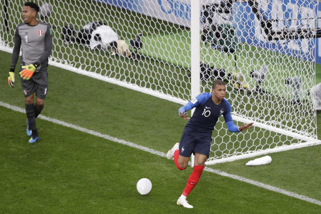 France's Kylian Mbappe celebrates after scoring the opening goal during the group C match between France and Peru at the 2018 soccer World Cup in the Yekaterinburg Arena in Yekaterinburg, Russia, Thursday, June 21, 2018. (AP Photo/Mark Baker)