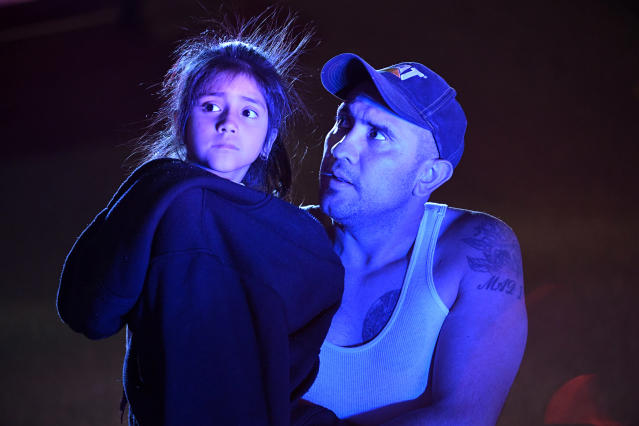 <p>A father and his scared daughter, who were customers inside Walmart, are escorted out of the parking lot and away from the scene of the Walmart store where a shooting occurred inside the store at 9901 Grant Street on Nov. 1, 2017 in Thornton, Colo. (Photo: Helen H. Richardson/The Denver Post via Getty Images) </p>