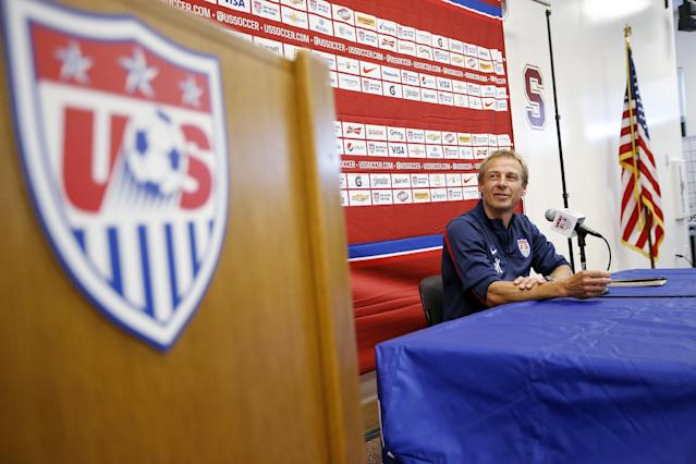 U.S. men's soccer coach Jurgen Klinsmann answers questions during a news conference Wednesday, May 14, 2014, in Stanford, Calif. The U.S. team is practicing at Stanford University before the team's May 27 exhibition against Azerbaijan at Candlestick Park in San Francisco. (AP Photo/Tony Avelar)