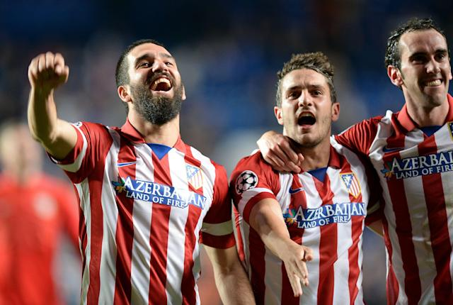 Atletico Madrid's Arda Turan, left, Koke, center, and Diego Godin celebrate after the Champions League semifinal second leg soccer match between Chelsea and Atletico Madrid at Stamford Bridge Stadium in London, Wednesday, April 30, 2014. (AP Photo/Andrew Matthews, PA Wire)