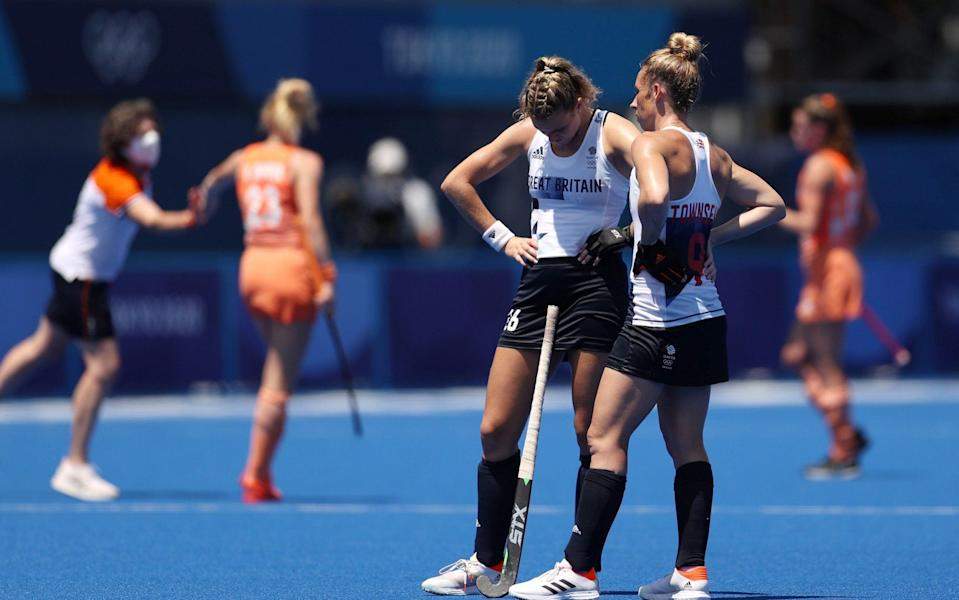 Susannah Townsend and Lily Owsley of Team Great Britain react after losing the Women's Semifinal match between Netherlands and Great Britain on day twelve of the Tokyo 2020 Olympic Games at Oi Hockey Stadium on August 04, 2021 in Tokyo - GETTY IMAGES