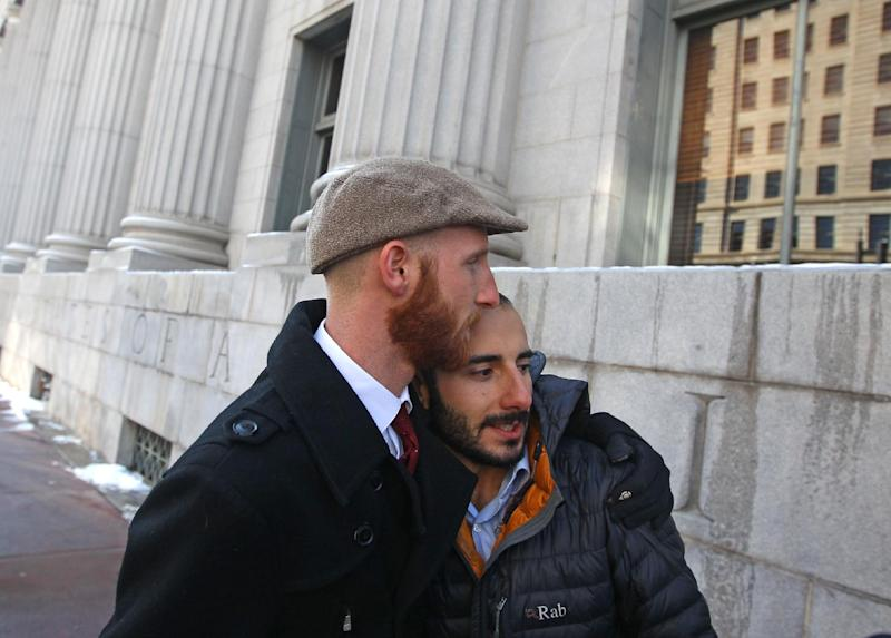 Derek Kitchen, left, and his partner Moudi Sbeity hug following court on Wednesday, Dec. 4, 2013, outside Frank E. Moss United States Courthouse, in Salt Lake City. A challenge to Utah's same-sex marriage ban by three gay couples was back in court Wednesday as a federal court judge heard arguments in the case. Kitchen and Sbeity are plaintiff's in this case. (AP Photo/Rick Bowmer)