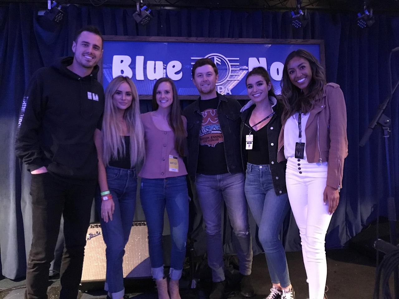 "<em>Bachelor</em> <a href=""https://people.com/tag/ben-higgins/"">Ben Higgins</a> poses with show alum <a href=""https://people.com/tag/amanda-stanton/"">Amanda Stanton</a>, <a href=""https://people.com/tag/american-idol/""><em>American Idol</em></a> winner <a href=""https://people.com/tag/scotty-mccreery/"">Scotty McCreery</a> and his wife Gabi and fellow <em>Bachelor</em> ladies <a href=""https://people.com/tag/Ashley-Iaconetti/"">Ashley Iaconetti</a> and Tayshia Adams at Blue Note at the JaM Cellars Ballroom."