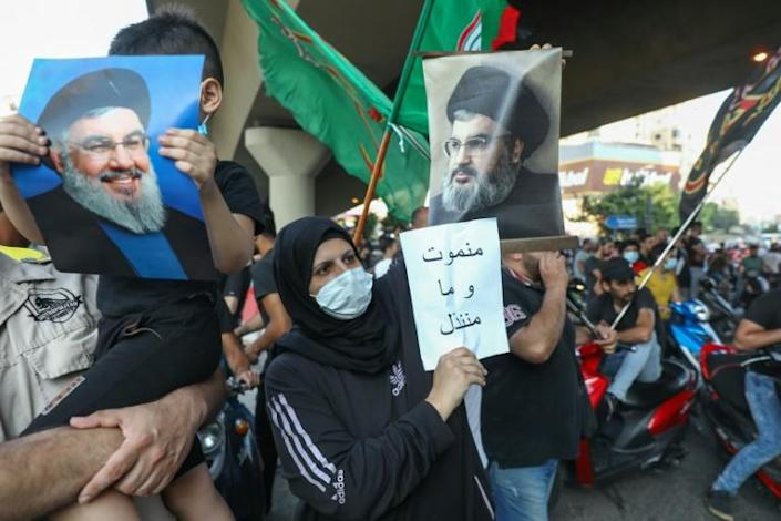 Supporters of Hezbollah hold pictures of leader Hassan Nasrallah during a protest against comments by the US ambassador to Lebanon criticising the Shiite group back in June
