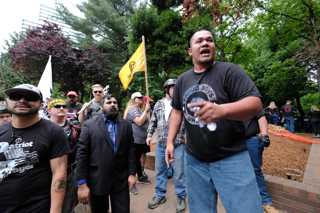 "Tusitala ""Tiny"" Toese (front), a member of both Proud Boys and Patriot Prayer, addresses supporters after fighting broke out between anti-fascist counterprotesters on June 3 in Portland, Oregon. (Photo: Alex Milan Tracy/Anadolu Agency via Getty Images)"