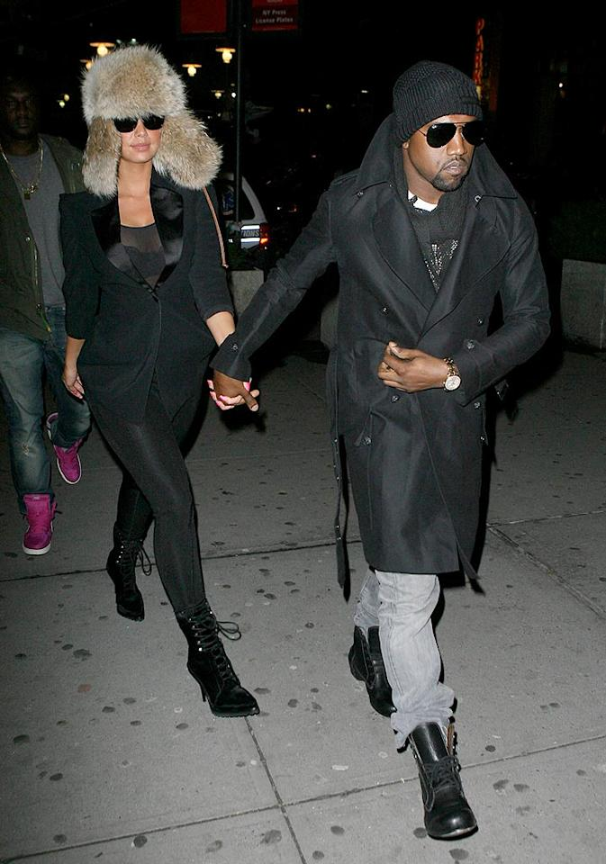 "Kanye ""I'm gonna let you finish"" West and his fashion-forward girlfriend Amber Rose donned dark shades and hats as they left the venue. Do you think their ensembles made them more or less noticeable to their fellow fans? T/<a href=""http://www.x17online.com"" target=""new"">X17 Online</a> - February 24, 2010"