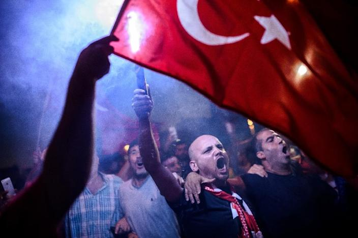 Supporters of President Recep Tayyip Erdogan rally in Istanbul's Taksim Square in July 2016 following a failed coup (AFP Photo/OZAN KOSE)