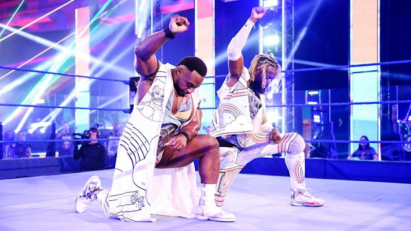 The New Day's Kofi Kingston and Big E take a knee during the opening of Smackdown on June 12, 2020. (Photo courtesy of WWE)