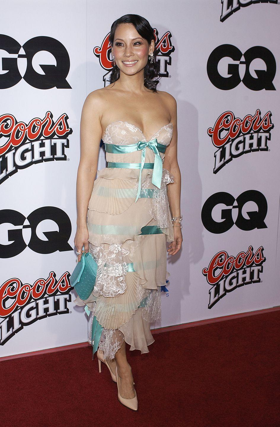 <p>Teal ribbons encased Liu in a blush dress made of pleated and laced tiers at the <em>Kill Bill: Volume 2</em> premiere. </p>