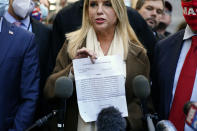 Former Florida Attorney General Pam Bondi displays a court order granting President Donald Trump's campaign more access to vote counting operations at the Pennsylvania Convention Center, Thursday, Nov. 5, 2020, in Philadelphia, following Tuesday's election. (AP Photo/Matt Slocum)