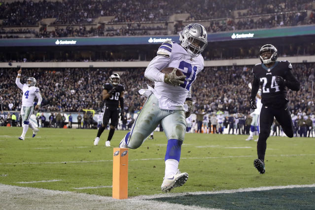 Running back Ezekiel Elliott (21) scores as Dak Prescott (4) celebrates, something the Cowboys hope to see a lot of this season. (AP)