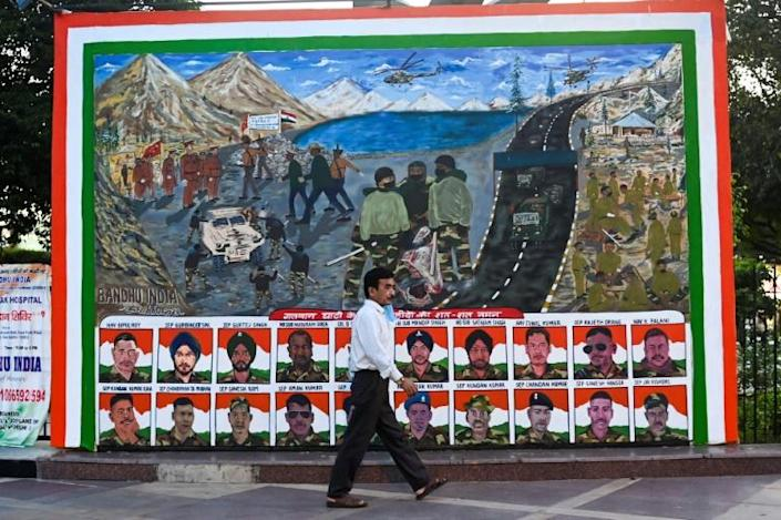 This picture in New Delhi includes portraits of Indian soldiers killed in a hand-to-hand fighting with Chinese soldiers on the borders high in the Himalayas