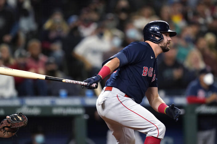 Boston Red Sox's Kyle Schwarber watches his three-run double against the Seattle Mariners during the eighth inning of a baseball game Tuesday, Sept. 14, 2021, in Seattle. (AP Photo/Elaine Thompson)