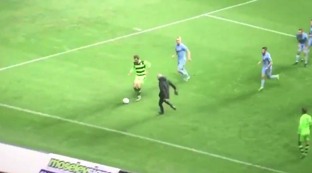 A Coventry fan ran onto the pitch, and players had to quell his anger. (Screenshot: @JoeCrossley_ on Twitter)