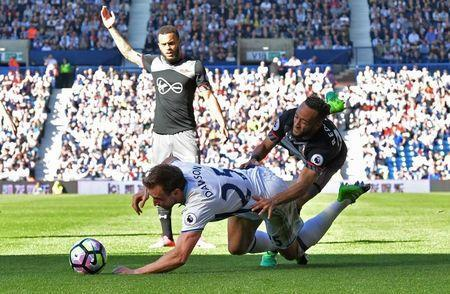 Britain Football Soccer - West Bromwich Albion v Southampton - Premier League - The Hawthorns - 8/4/17 Southampton's Nathan Redmond in action with West Bromwich Albion's Craig Dawson Reuters / Anthony Devlin Livepic