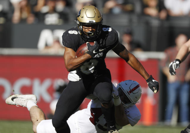 Colorado running back Alex Fontenot, front, is pulled down after a short gain by Stanford cornerback Ethan Bonner in the first half of an NCAA college football game Saturday, Nov. 9, 2019, in Boulder, Colo. (AP Photo/David Zalubowski)