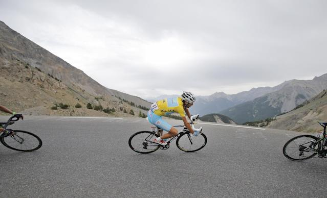 Italy's Vincenzo Nibali, wearing the overall leader's yellow jersey, speeds down Izoard pass during the fourteenth stage of the Tour de France cycling race over 177 kilometers (110 miles) with start in Grenoble and finish in Risoul, France, Saturday, July 19, 2014. (AP Photo/Christophe Ena)