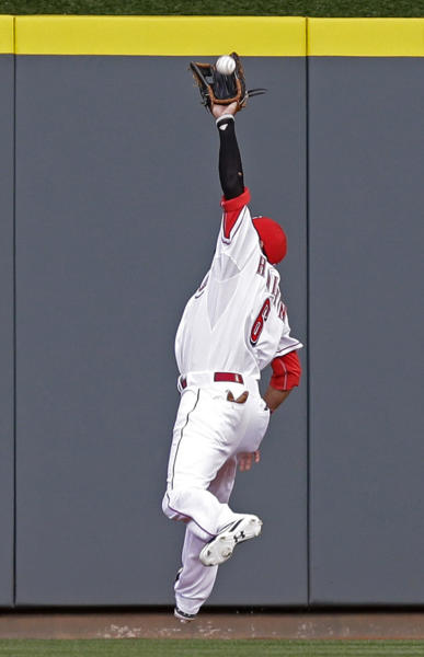 Cincinnati Reds center fielder Billy Hamilton catches a fly ball hit by Chicago Cubs' Junior Lake in the first inning of a baseball game on Wednesday, April 30, 2014, in Cincinnati. (AP Photo)