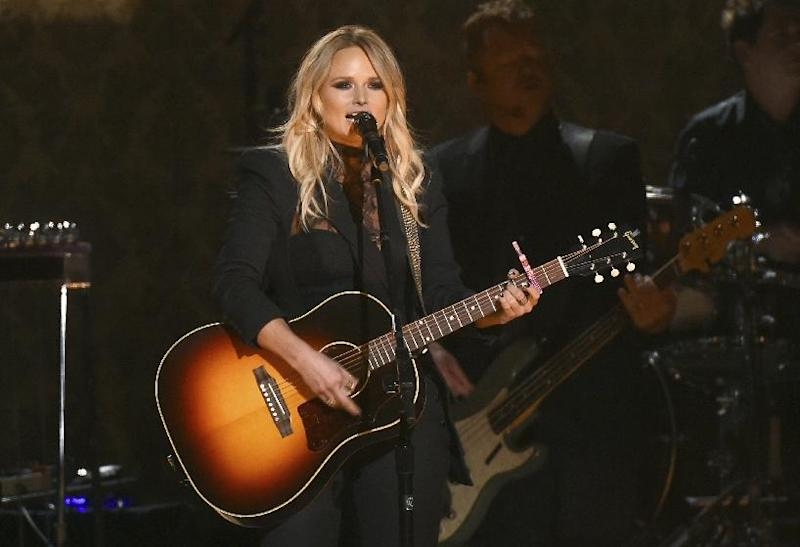 """FILE - In this Nov. 2, 2016 file photo, Miranda Lambert performs """"Vice"""" at the 50th annual CMA Awards at the Bridgestone Arena  in Nashville, Tenn. Double albums are rare these days and the best ones came out decades ago in vinyl form.  Lambert revives that tradition in an expansive new album, """"The Weight of These Wings,"""" which emphasizes the duality of her personality on disc A's """"The Nerve"""" and disc B's """"The Heart."""" At times, the album feels a bit repetitive, but there are enough standout songs to make it worth the extra time.(Photo by Charles Sykes/Invision/AP)"""