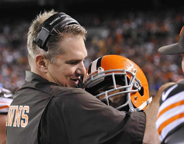 Cleveland Browns coach Rob Chudzinski hugs strong safety T.J. Ward after Ward returned an interception for a touchdown in the fourth quarter of an NFL football game against the Buffalo Bills on Thursday, Oct. 3, 2013, in Cleveland. The Browns won 37-24. (AP Photo/David Richard)