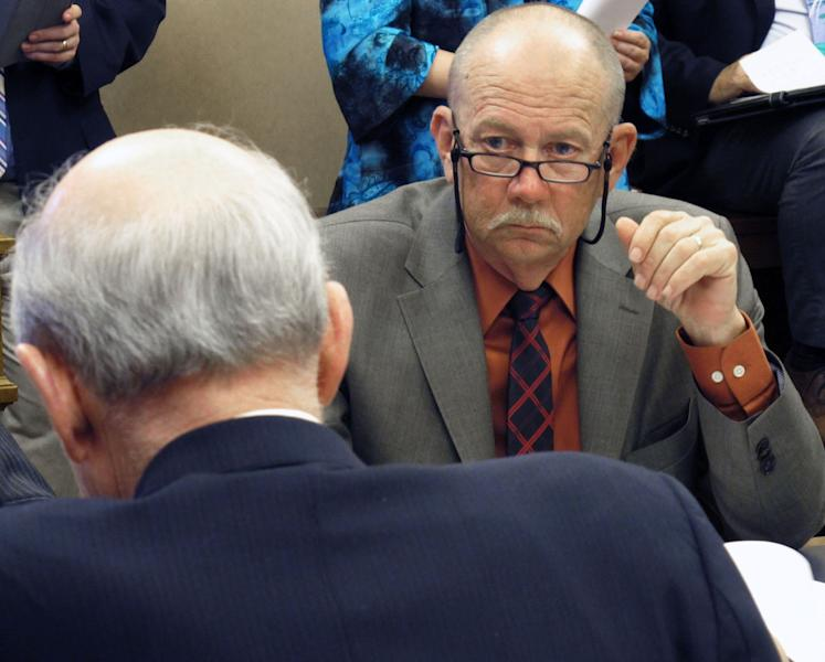 Kansas state Rep. Nile Dillmore, a Wichita Democrat, listens during negotiations between House members and senators over tax issues, Wednesday, April 25, 2012, at the Statehouse, in Topeka, Kan. (AP Photo/John Hanna)