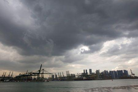 FILE PHOTO: Singapore's skyline and port January 18, 2018.    REUTERS/Thomas White/File Photo