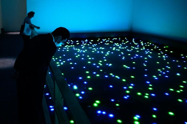 To view pieces like this work by artist Tatsuo Miyajima, visitors will have to reserve in advance and wear a face mask