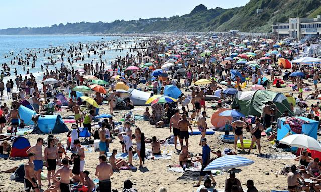 Beachgoers enjoy the sunshine in Bournemouth (Picture: Getty)