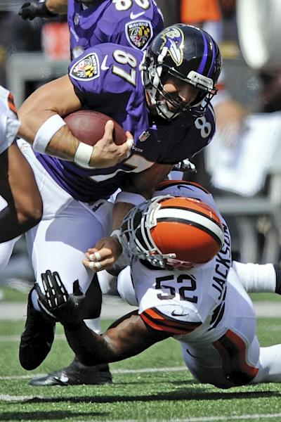 Baltimore Ravens tight end Dallas Clark (87) is tackled by Cleveland Browns inside linebacker D'Qwell Jackson (52) during the first half of a NFL football game in Baltimore, Md., Sunday, Sept. 15, 2013. (AP Photo/Nick Wass)