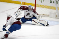 Colorado Avalanche goalie Philipp Grubauer (31) blocks a shot by the Anaheim Ducks during the third period of an NHL hockey game in Anaheim, Calif., Friday, Jan. 22, 2021. (AP Photo/Ringo H.W. Chiu)
