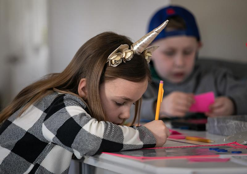NEW ROCHELLE, - MARCH 18: Nola Eaton, 6, and her brother Cam, 9, take part in home schooling on March 18, 2020 in New Rochelle, New York. Schools in New Rochelle, a hot spot in the U.S. for the coronavirus (COVID-19) pandemic, were suspended on March 13, and parents have been tasked with carrying out distance learning programs at home. Nola's mother, Farrah Eaton, a former high school administrator, said she plans to hold sessions with her three children from 9am-12pm Monday-Friday. (Photo by John Moore/Getty Images)