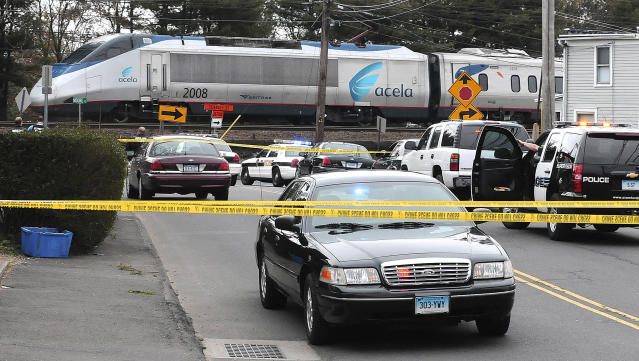 In this photo provided by Harold Cobin, traffic is halted and an Amtrak Acela train sits on the track in Norwalk, Conn., Friday, April 19, 2013, after Norwalk police were asked by Boston police to search the train for Dzhokhar Tsarnaev, the the remaining Boston Marathon bombings suspect. An Amtrak spokesman said the southbound train was allowed to continue to Washington about 9:30 a.m. Amtrak suspended service between Boston and Providence, R.I., about 5:45 a.m., Friday at the request of Massachusetts authorities. (AP Photo/Harold Cobin)