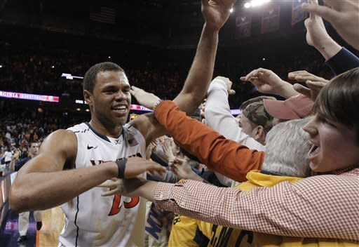 Virginia guard Justin Anderson celebrates with fans after Virginia defeated Duke 73-68 in an NCAA college basketball game in Charlottesville, Va., Thursday, Feb. 28, 2013. (AP Photo/Steve Helber)