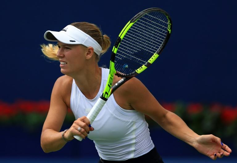 Caroline Wozniacki of Denmark plays a shot against Sloane Stephens of the US during their WTA Rogers Cup semi-final match, at Aviva Centre in Toronto, Canada, on August 12, 2017
