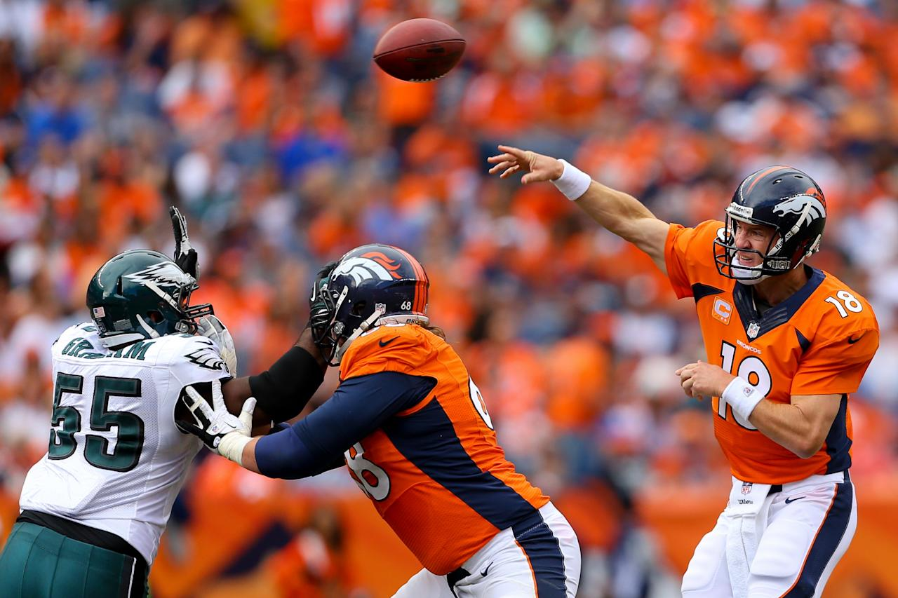 DENVER, CO - SEPTEMBER 29: Quarterback Peyton Manning #18 of the Denver Broncos throws a pass during the third quarter against the Philadelphia Eagles at Sports Authority Field Field at Mile High on September 29, 2013 in Denver, Colorado. The Broncos defeated the Eagles 52-20. (Photo by Justin Edmonds/Getty Images)