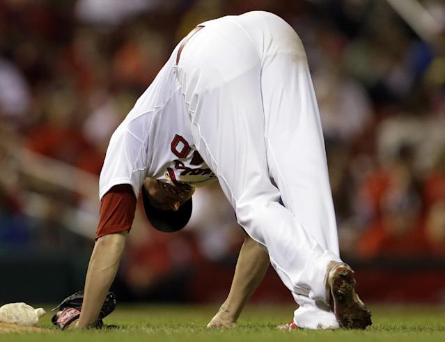 St. Louis Cardinals starting pitcher Shelby Miller stretches in an attempt rid himself of a cramp during the fifth inning of a baseball game against the Chicago Cubs on Monday, June 17, 2013, in St. Louis. Miller stayed in the game and finished the half inning but was replaced by a pinch hitter in the home half of the fifth inning. (AP Photo/Jeff Roberson)