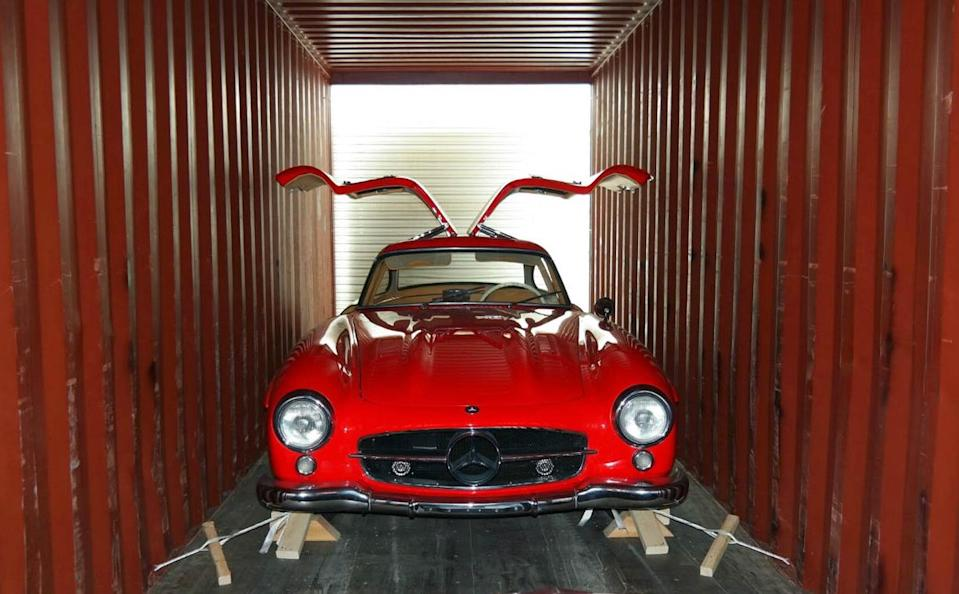 Classic car in shipping container