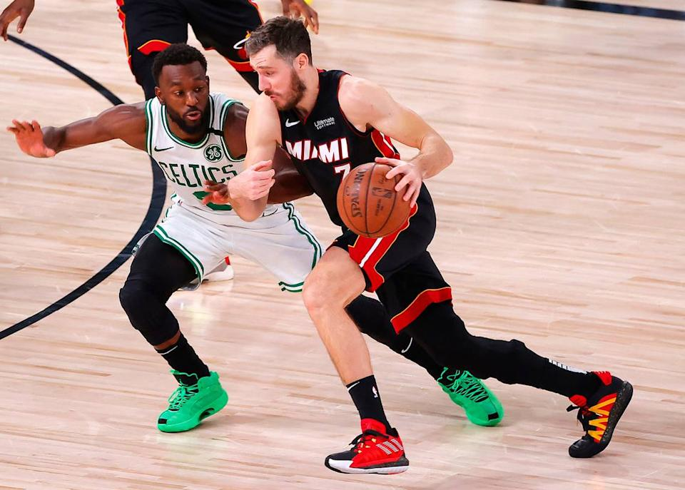 LAKE BUENA VISTA, FLORIDA - SEPTEMBER 27: Goran Dragic #7 of the Miami Heat drives against Kemba Walker #8 of the Boston Celtics during the third quarter in Game Six of the Eastern Conference Finals during the 2020 NBA Playoffs at AdventHealth Arena at the ESPN Wide World Of Sports Complex on September 27, 2020 in Lake Buena Vista, Florida. NOTE TO USER: User expressly acknowledges and agrees that, by downloading and or using this photograph, User is consenting to the terms and conditions of the Getty Images License Agreement. (Photo by Kevin C. Cox/Getty Images)