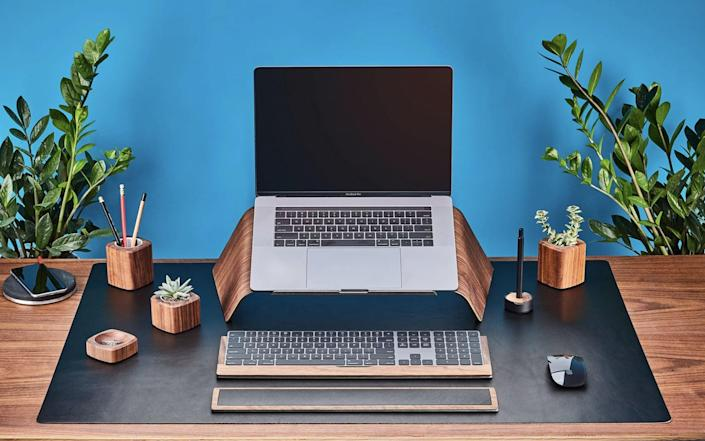 <p>Upgrading their workspace is easy with the <span>Grovemade Wood Laptop Stand</span> ($150). Constructed at an angle, the stand is perfect for anyone who regularly uses their computer at home.</p>