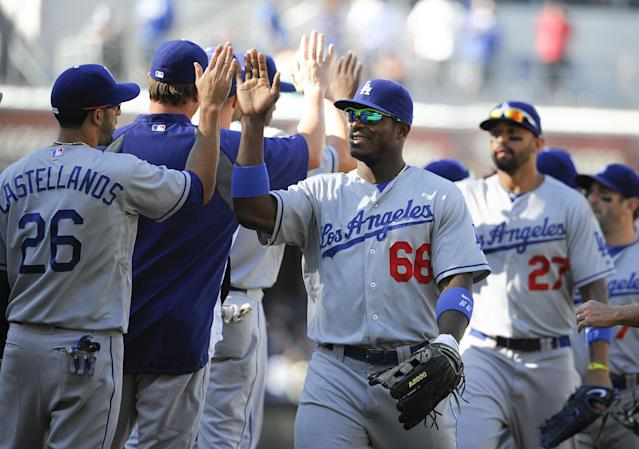 SAN DIEGO, CA - SEPTEMBER 22: Los Angeles Dodgers players high-five after beating the San Diego Padres 1-0 in a baseball game at Petco Park on September 22, 2013 in San Diego, California. (Photo by Denis Poroy/Getty Images)