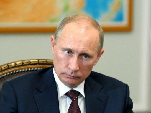 Russia's President Vladimir Putin chairs a meeting near Moscow on July 13