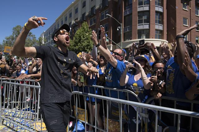 <p>Golden State Warriors guard Stephen Curry (30) walks the street during the Warriors 2017 championship victory parade in downtown Oakland. Mandatory Credit: Kyle Terada-USA TODAY Sports </p>