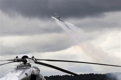 A SAAB Gripen jet takes off for a display during Farnborough International Airshow, Farnborough, England, Monday, July 9, 2012. (AP Photo/Sang Tan)