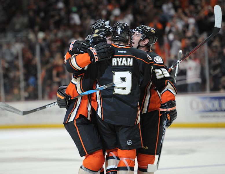 Anaheim Ducks' Francois Beauchemin (23) and Bobby Ryan (9) congratulate Sheldon Brookbank, left, after he scored a goal against the Chicago Blackhawks in the second period of an NHL hockey game in Anaheim, Calif., Sunday, Feb. 26, 2012. (AP Photo/Lori Shepler)