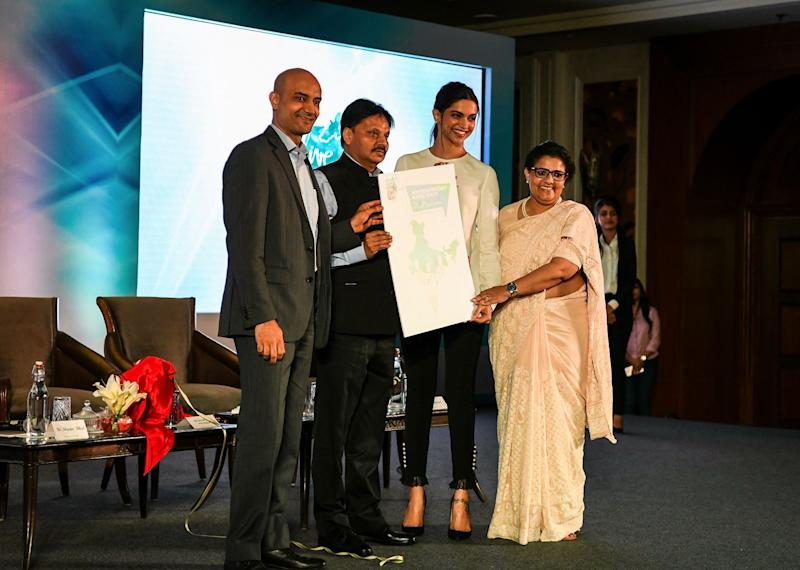 """Indian Bollywood actress Deepika Padukone (2nd R), founder of the Live Love Laugh Foundation, is joined by foundation trustee Shyam Bhat (L), trustee board chair Anna Chandy (R), and Indian Department of Health and Family Welfare additional secretary Sanjeeva Kumar (2nd L) attend the unveiling event for a report on the public perception towards mental health in India, in New Delhi on March 23, 2018. Bollywood star Deepika Padukone called March 23 for bolder efforts by Indians to end the stigma surrounding people suffering from mental illness. """"We have a long way to go,"""" said the Bollywood A-lister who went public about her struggle with depression in 2015, prompting praise for her campaign to spark public discourse on mental health in a country that has traditionally considered such illnesses taboo. (Photo by CHANDAN KHANNA/AFP/Getty Images)"""