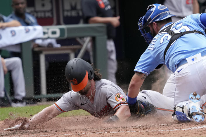 Baltimore Orioles' Ryan McKenna, left, beats the tag by Kansas City Royals catcher Cam Gallagher (36) during the sixth inning of a baseball game at Kauffman Stadium in Kansas City, Mo., Sunday, July 18, 2021. (AP Photo/Orlin Wagner)
