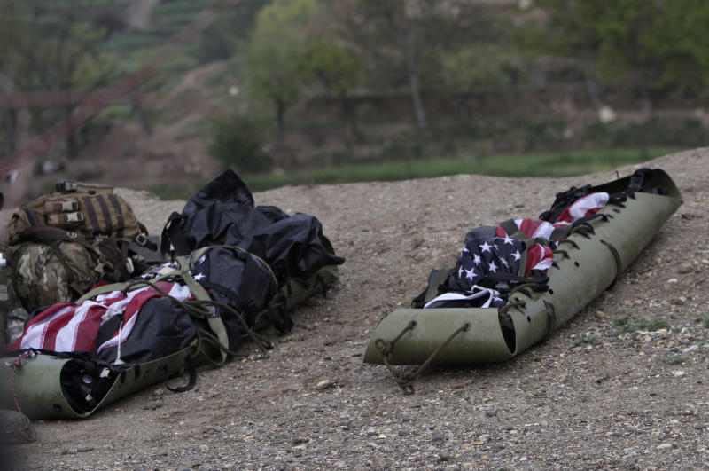The remains of two U.S. soldiers are wrapped in the American flag and body bags after a NATO helicopter crashed killing two American service members in a field near Gerakhel, eastern Afghanistan, Tuesday, April 9, 2013. The U.S.-led International Security Assistance Force said the cause of the crash is under investigation but initial reporting indicates there was no enemy activity in the area at the time. It did not immediately identify the nationalities of those killed. But a senior U.S. official confirmed they were Americans. (AP Photo/Rahmat Gul)